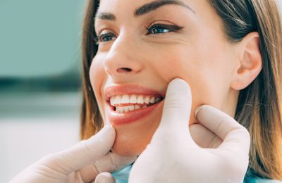 Young smiling woman with beautifiul teeth, having a dental inspection